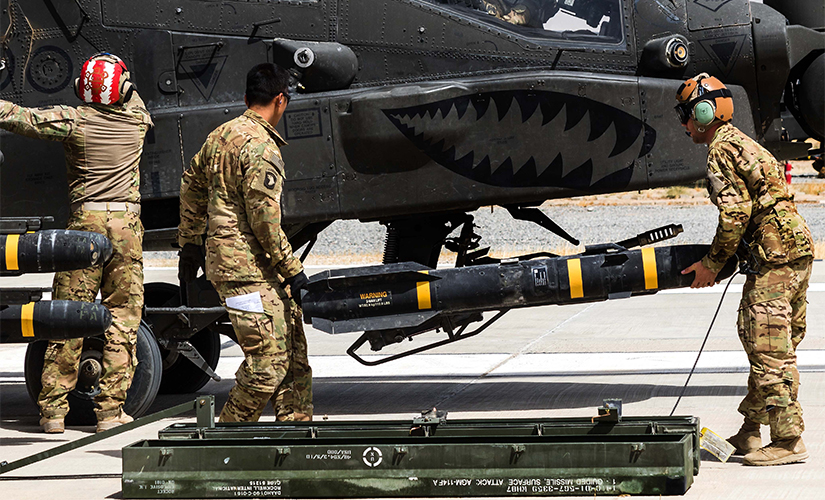 AGM-114 Hellfire missile loaded onto an AH-64E Apache helicopter