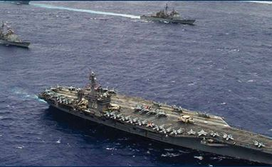 Image of three military ships in open water.