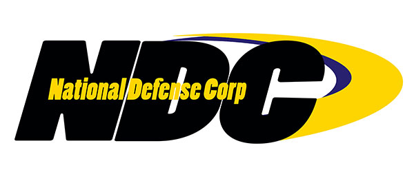 """Amtec NDC Logo: There are three large black letters: """"NDC"""". Inside the letters the following in gold lettering: National Defense Corp. There is also a yellow swoosh that starts on the top of the """"D"""" in NDC and continues around and to the bottom of the """"C"""" in NDC."""