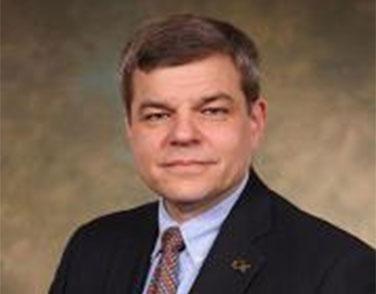 Headshot of Tom Kurfess