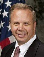 Head shot of Robert Butler, Senior Vice President, Critical Infrastructure Program, AECOM Management Services