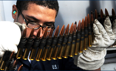 Photo of African American man looking at ammunition
